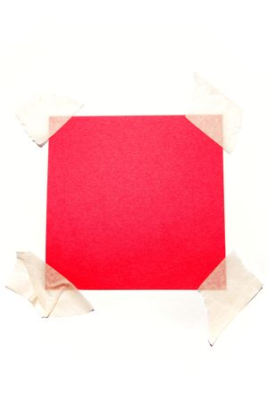 taped: Piece of red paper taped to white