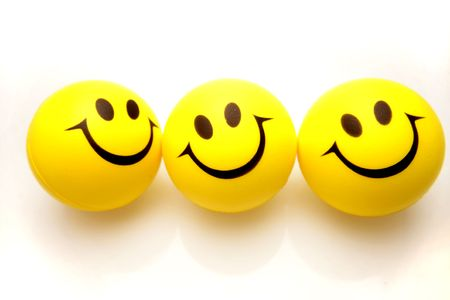 three objects: Three smiley faces Stock Photo