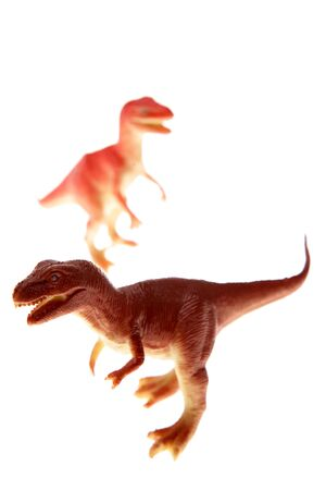 Plastic dinosaurs isolated over white background Stock Photo - 3280998