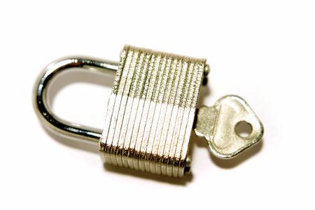 Padlock and key on white photo