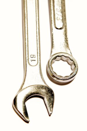 Two spanners over white photo
