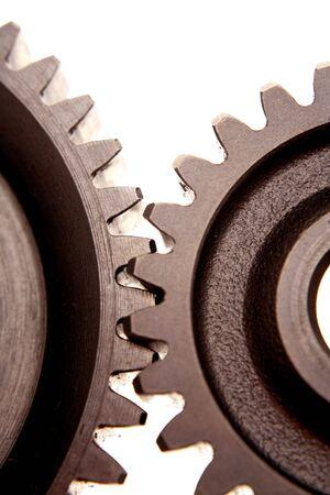 meshing: Two gears meshing together closeup