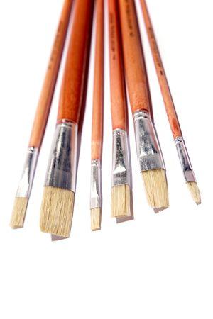 varied: Paintbrushes over white