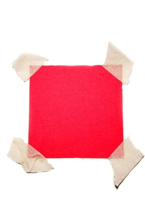 taped: Red paper taped to white Stock Photo