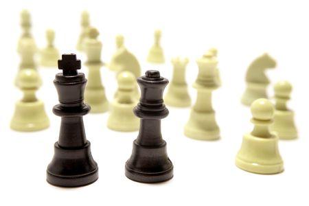 analogy: Chess pieces on white background Stock Photo