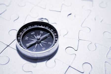 finished: Compass on puzzle Stock Photo