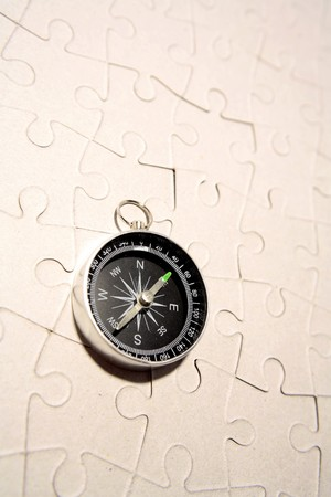 Compass on puzzle photo