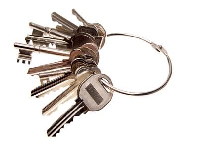 varied: Bunch of keys on white background