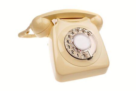rotary dial telephone: Tel�fono rotativo sobre blanco Foto de archivo