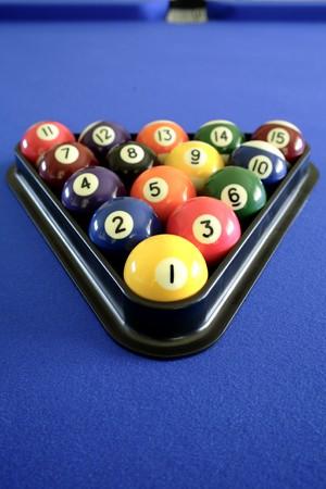 Pool balls on blue table photo
