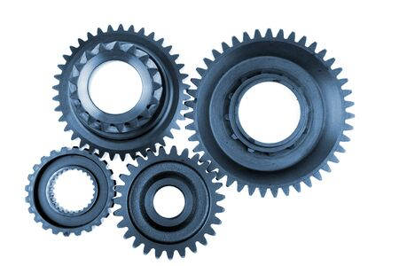 Steel gears meshing together over white photo