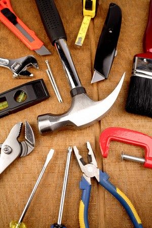 Tools on wooden panel Stock Photo - 4356178