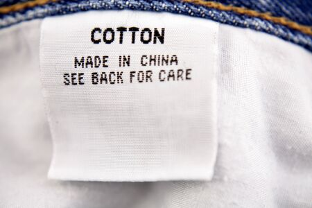 Cotton label on jeans Stock Photo