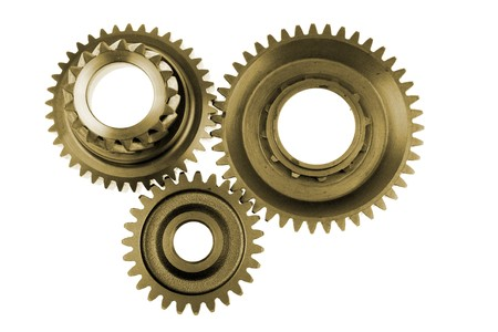 Three gears meshing together over white photo