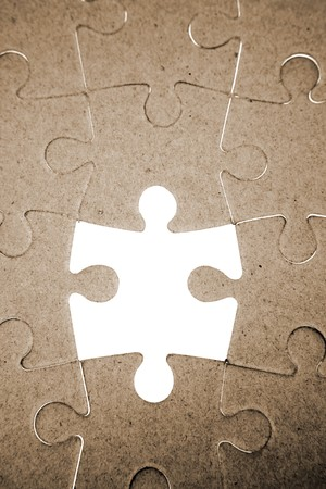 Piece missing from jigsaw puzzle Stock Photo - 4471090