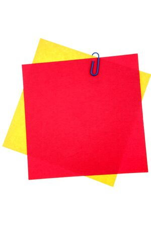 Blank papers held by clip on white background photo