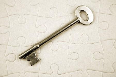 Key on puzzle Stock Photo - 4528979