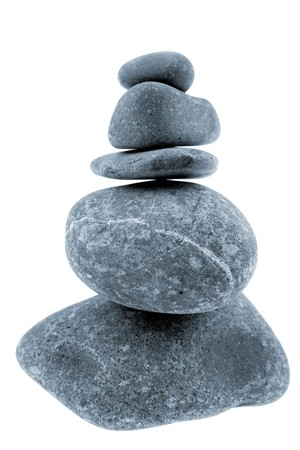 steadiness: River rocks stacked on white background Stock Photo
