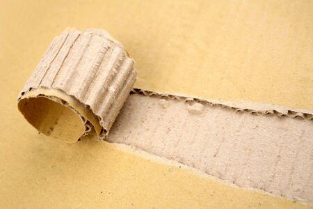 Rip in cardboard Stock Photo - 4638178