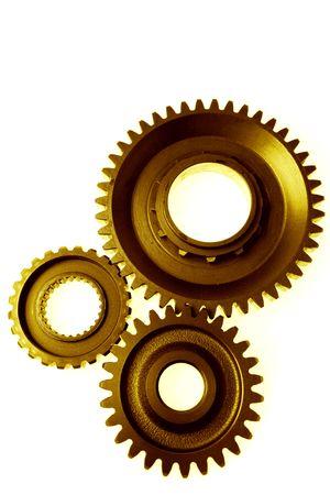 Closeup of three cogwheels on white photo