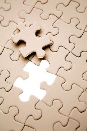 Final piece to complete jigsaw puzzle Stock Photo - 4731287
