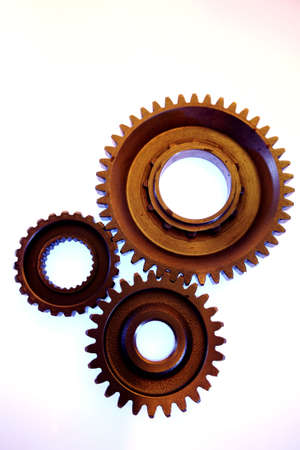 meshing: Three steel gears meshing together