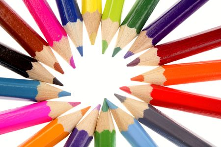 Colored pencils on white background photo