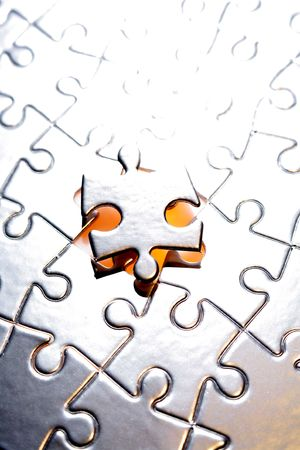 Final piece of jigsaw puzzle Stock Photo - 4915175