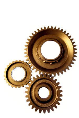 Three steel cogwheels together on white background photo