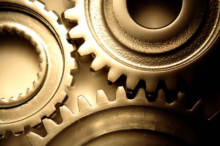 interlock: Three steel gears joining together