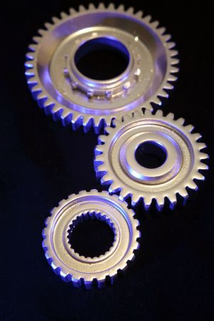 Three steel gears joining together photo