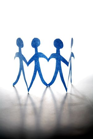 Four paper dolls on plain background photo