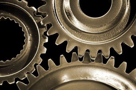 interlink: Closeup of three gears binding together Stock Photo