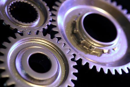 Closeup of three gears binding together photo