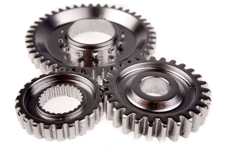 business gears: Three gears meshing together over white Stock Photo