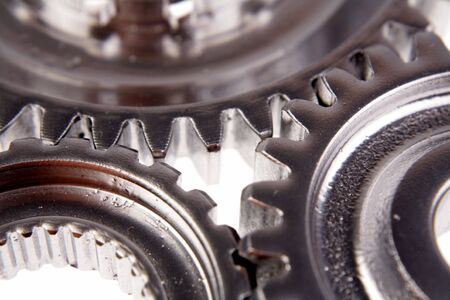 Closeup of three cogs joining together photo