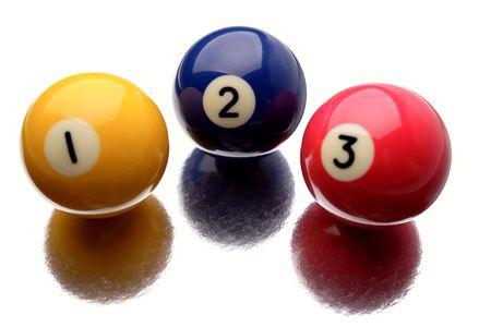 Three pool balls on white background photo