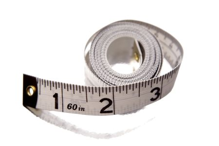 Tape measure rolled on white background photo