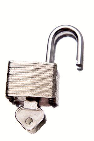 unleash: Padlock and key on white