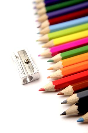 Colored pencils and sharpener photo