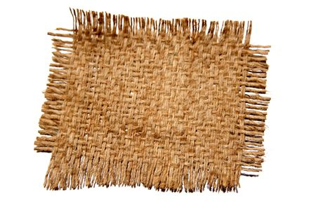 Piece of frayed burlap on white background photo