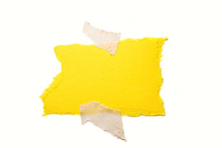 taped: Yellow ripped paper taped to white Stock Photo
