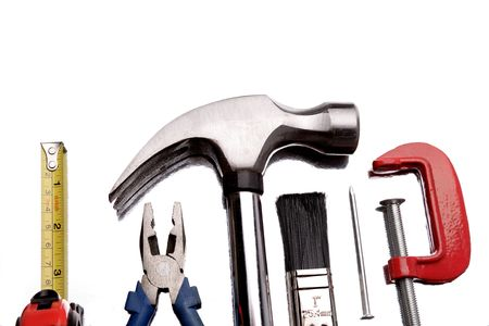 Construction tools over white background photo