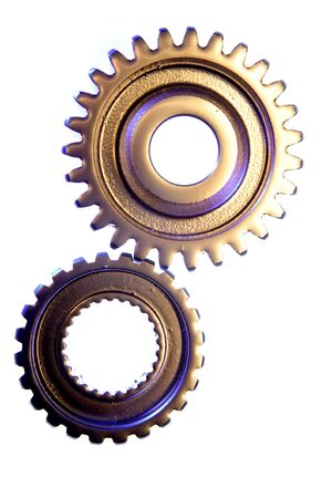 Two gears meshing together over white photo