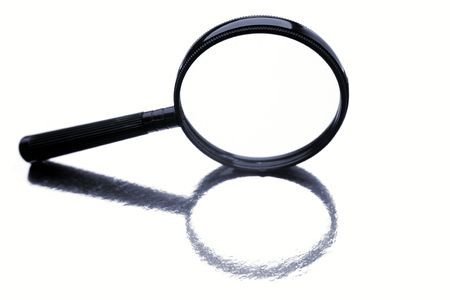 Magnifying glass isolated over white background Stock Photo - 5292532