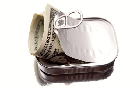 Roll of American banknotes inside tin can photo