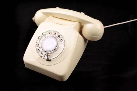 rotary dial telephone: Tel�fono rotativo sobre negro  Foto de archivo