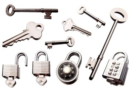 Keys and padlocks isolated over white background photo