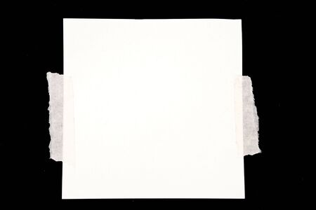 taped: Note paper taped to black background Stock Photo
