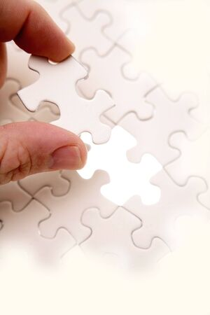 seperation: Fingers holding puzzle piece